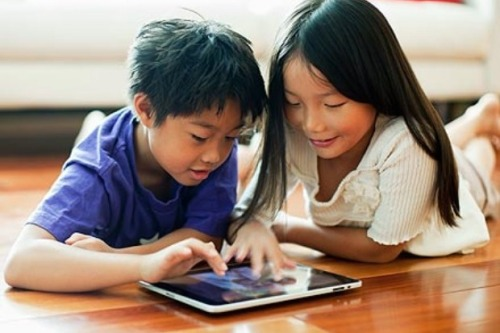 Kids playing with a tablet
